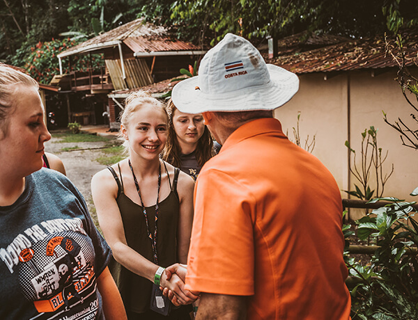 Student shaking hands with a local Costa Rica tour guide