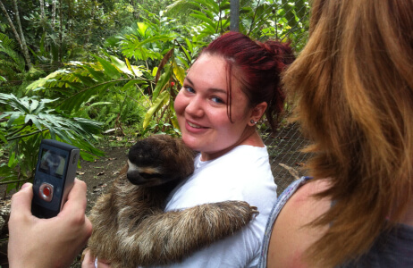 A student holding a sloth