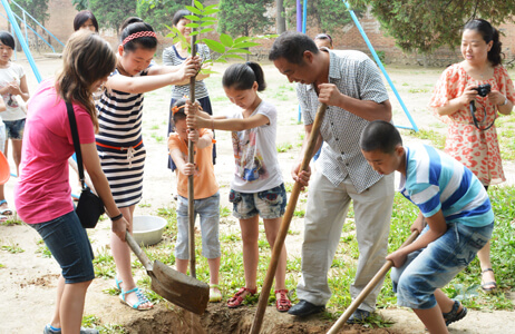 Students and local children planting trees