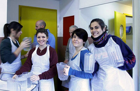 Students helping in a soup kitchen