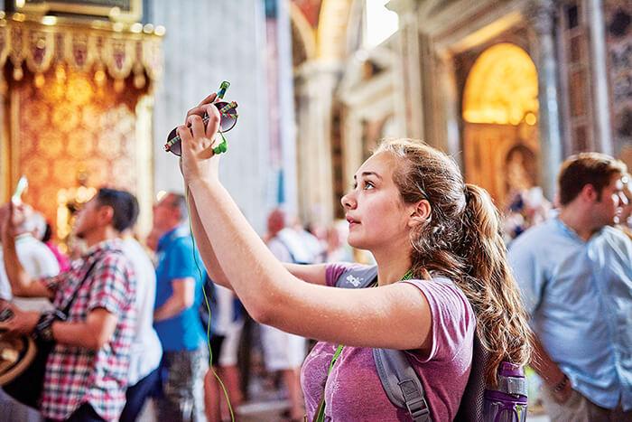 Student taking photos inside a church