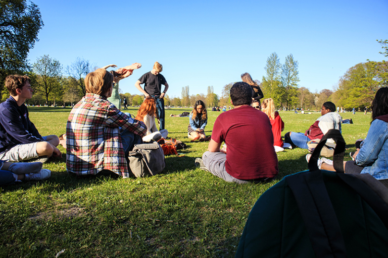 ACIS group resting at a park