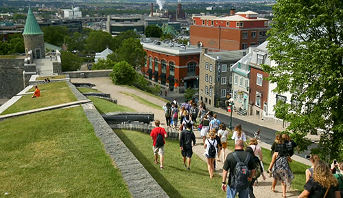 Group walking through Place d'Youville in Canada