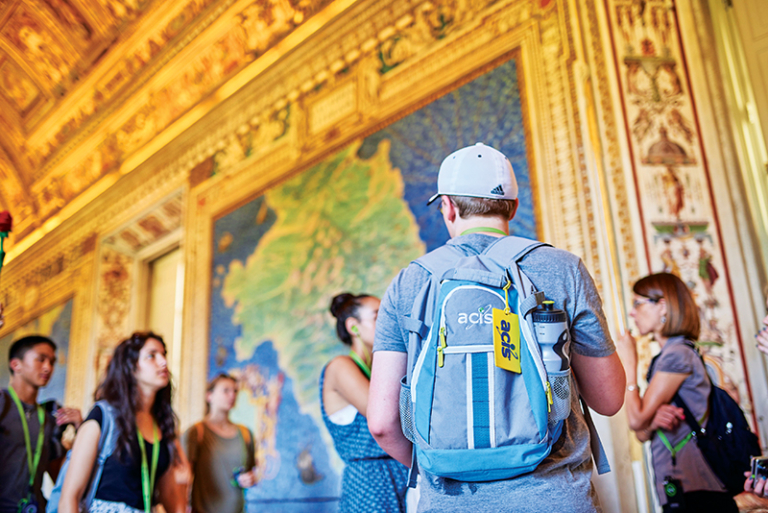 Students standing in a hall in the Vatican museum