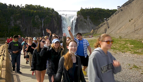 ACIS America group walking away from Montmorency Falls
