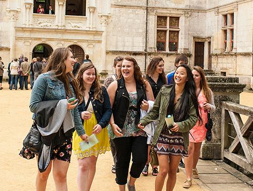 Girls walking through château d'azay-le-rideau in France