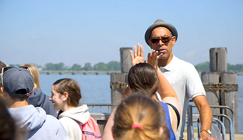 Students high-fiving a tour guide