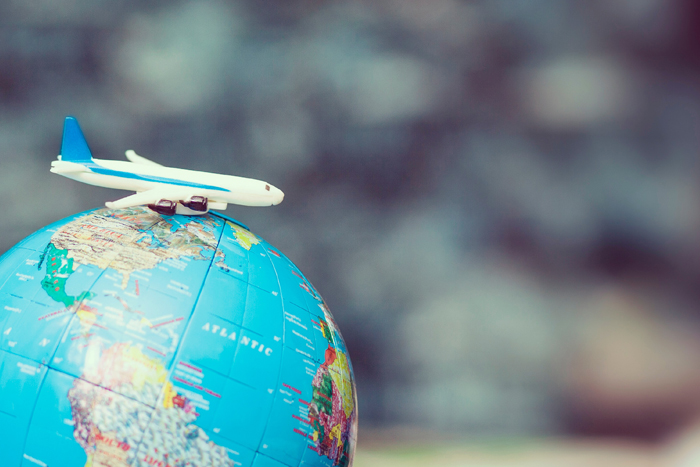 small airplane model on top of a globe