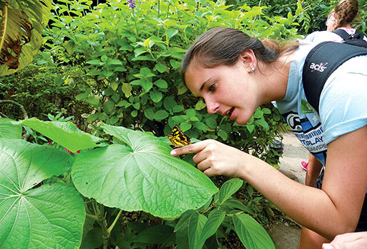 Student in Costa Rica with Butterfly