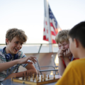 Students playing chess on a ferry in Washington D.C.