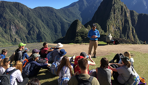 Group of students with tour guide at Machu Picchu