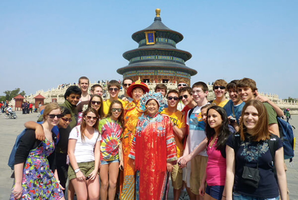 Students pose with local in Beijing