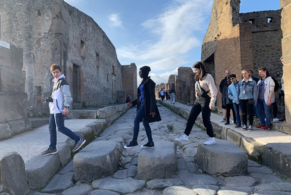 Students walking on steps in Pompeii