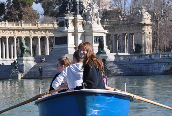 Students rowing a boat in park in Madrid
