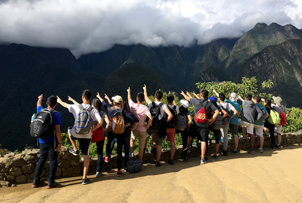 Group in Peru pointing towards the distance