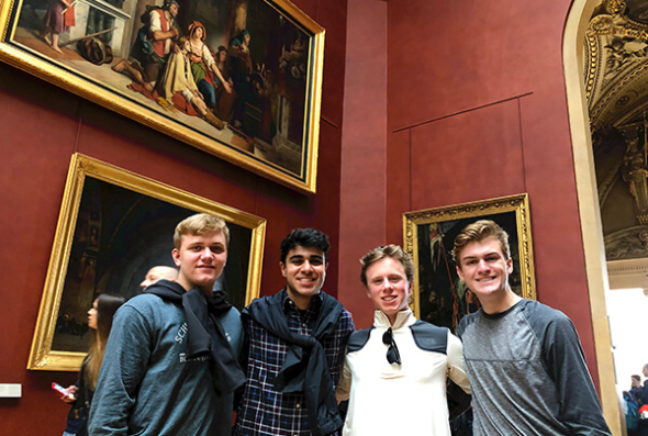 Group of boys inside the Louvre