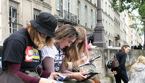 ACIS students water coloring in Paris