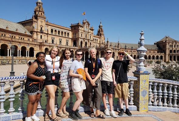 Group of students pose in Plaza de España