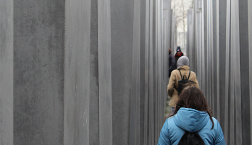 Students walk through the Berlin Holocaust Memorial