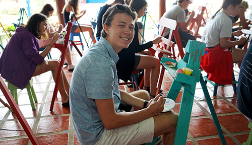 Students painting on easels in Costa Rica