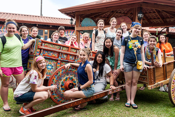 ACIS group posing around a Sarchi ox cart