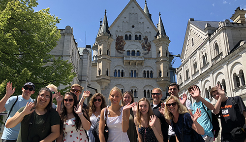 Students pose in front of Neuschwanstein Castle