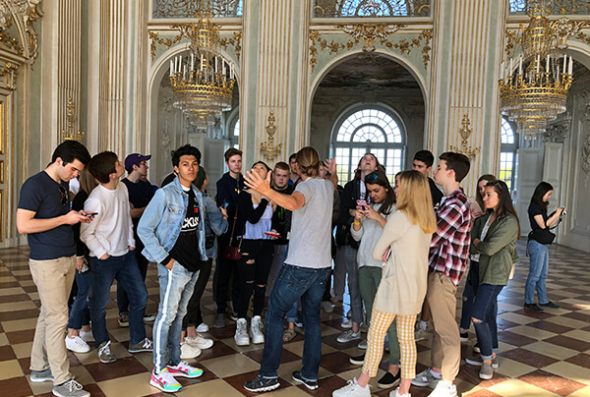 Students tour the inside of Nymphenburg Palace