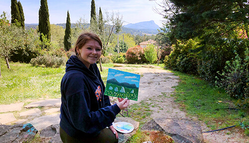 Student holding her Cezanne inspired painting