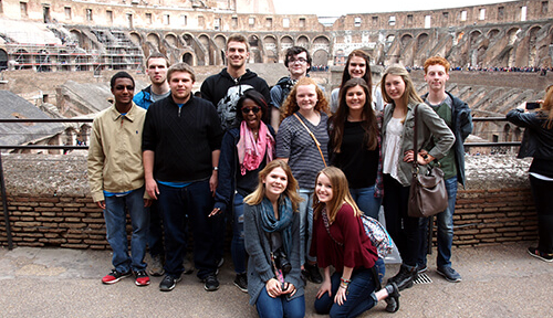Group inside the rome colosseum