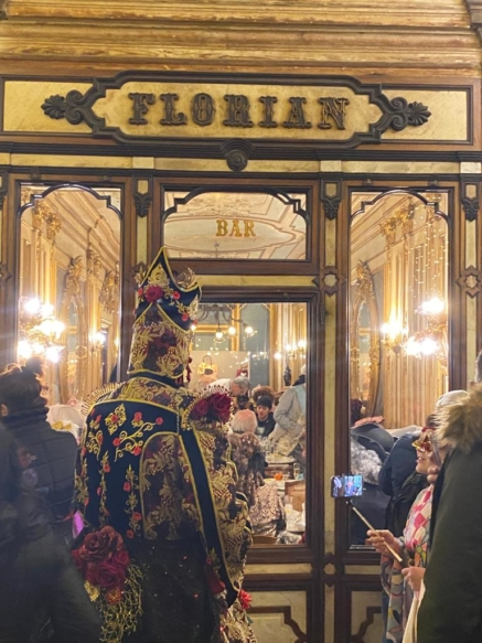 Carnevale attendee in an ornate disguise
