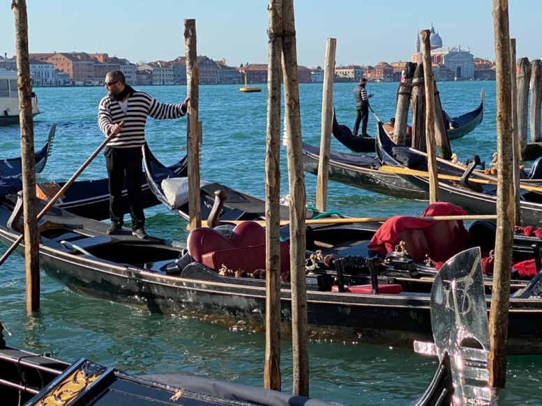 Gondolas and  gondoliers at their moorings
