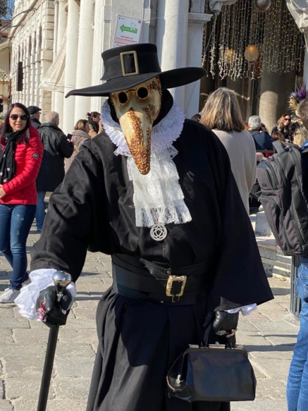 A person wearing a costume of a Medico della peste (Plague doctor)