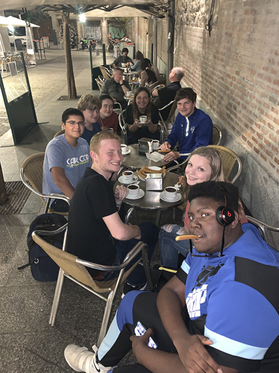 Tim's group enjoying churros and chocolate in Madrid