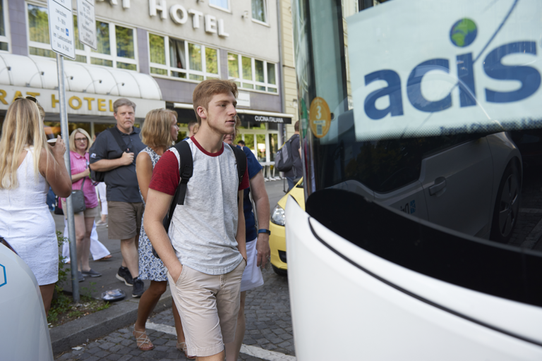 students boarding a private bus in Bavaria