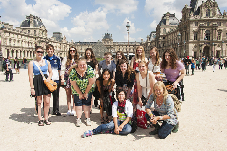 Group posed in front of the Louvre
