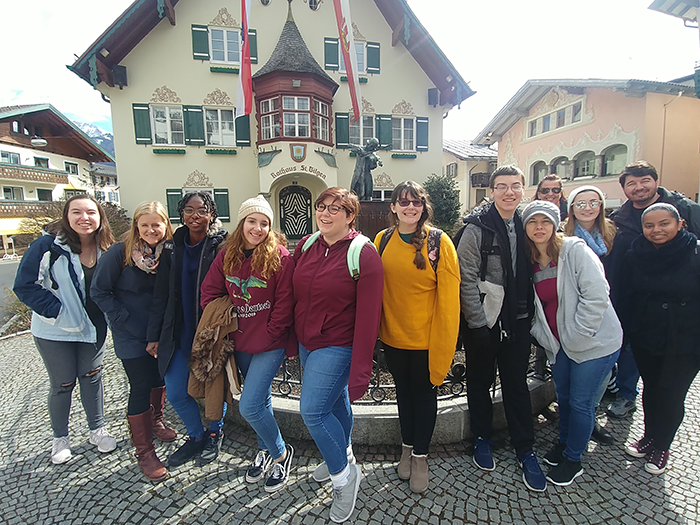 A group poses near St Gilgen's town hall