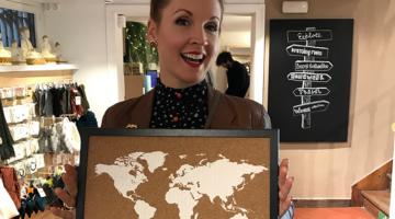 Program Consultant Tricia holding a map souvenir