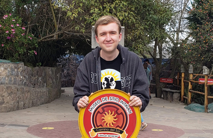 ACIS Student stands on the equator