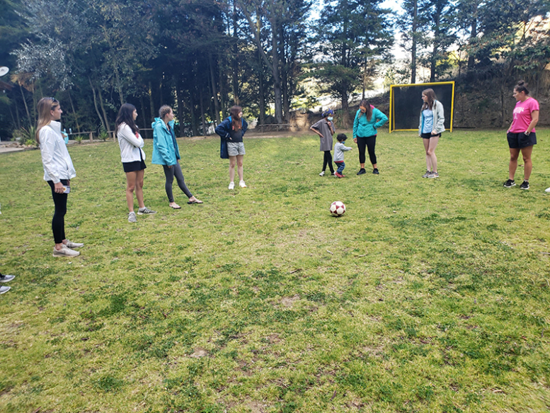 ACIS student travelers playing soccer in Ecuador