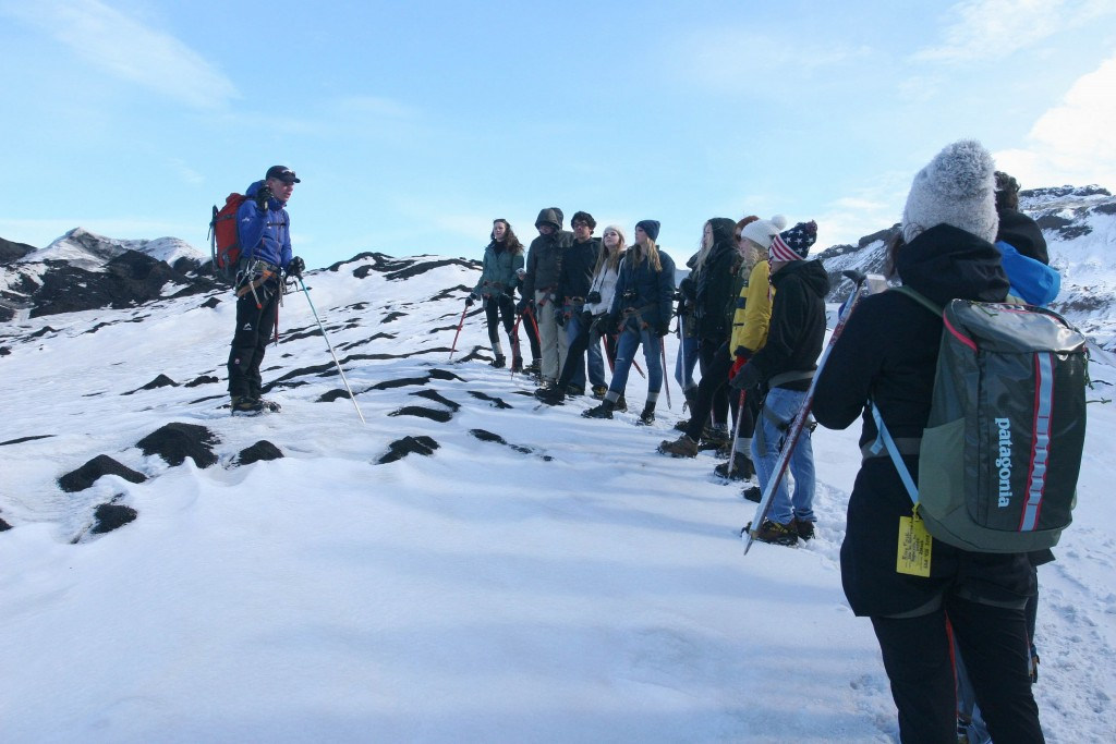 Glacier walk on ACIS' Discoveirng STEM in Iceland trip | Description: Students and instructor on snowy mountain